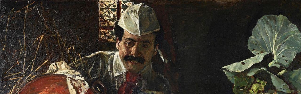 Ausschnitt des Selbstporträts von Max Liebermann. Es zeigt links einen Mann, der eine weiße Küchenkappe trägt und einen Schnauzbart hat. Rechts ist ein großes Blattgemüse.